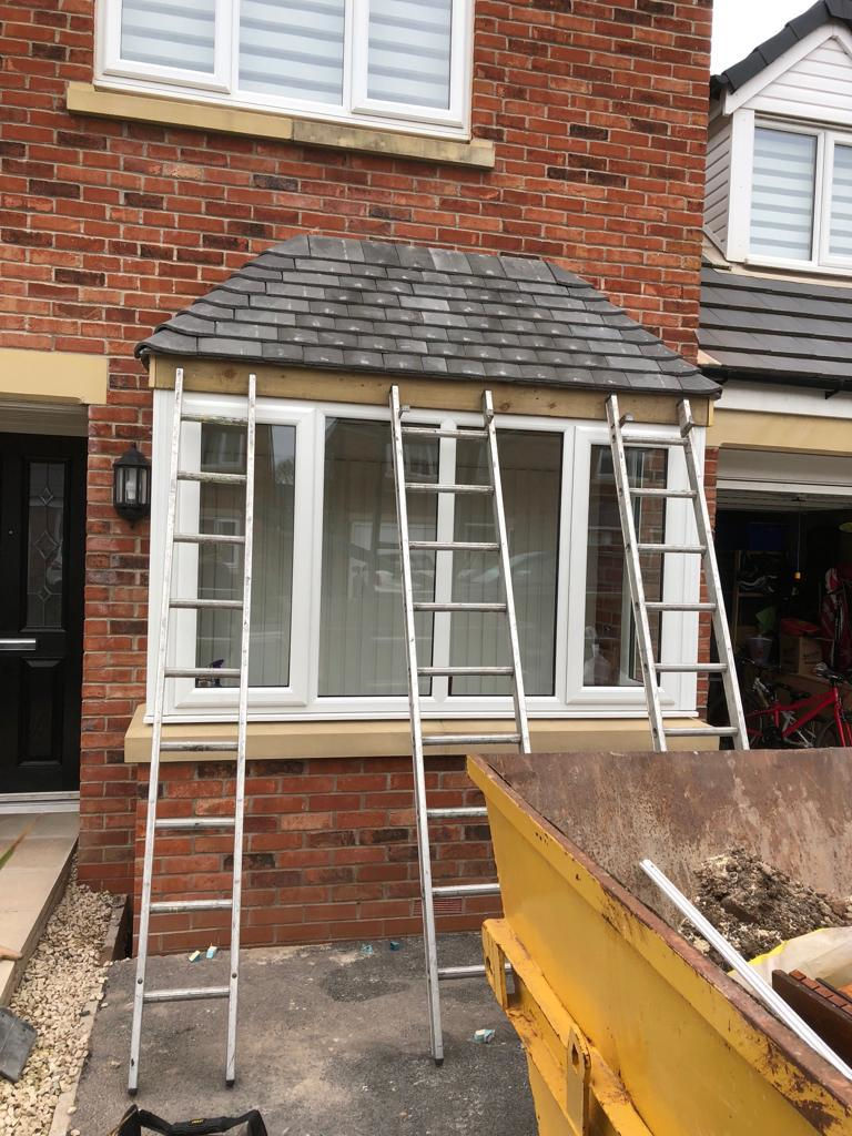 Garage door removed and replaced with brick work for bay window extension