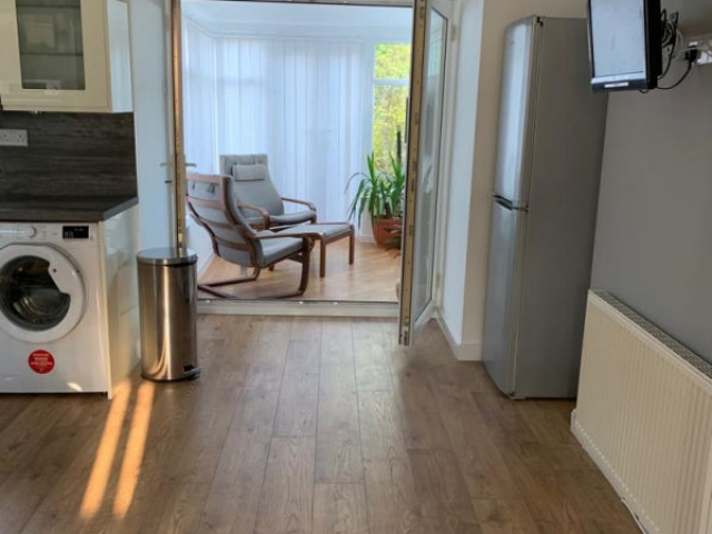 Real oak wood floor fitted and new French glass doors