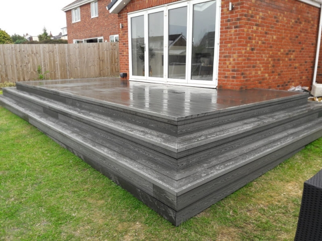 Composite deck with outside lights built by Four Seasons Roof Systems