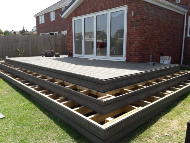 Composite deck with outside lights being built by Four Seasons Roof Systems